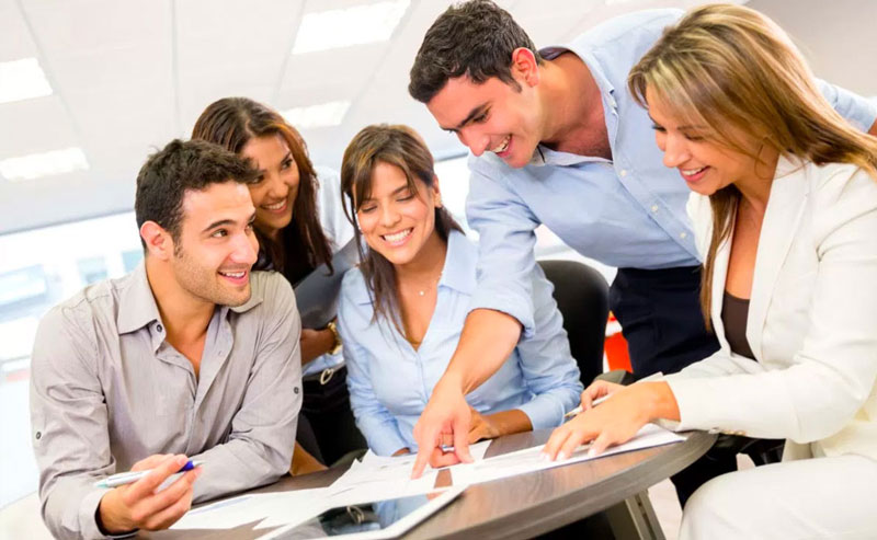 Invoice Finance -Business people working as a team at the office